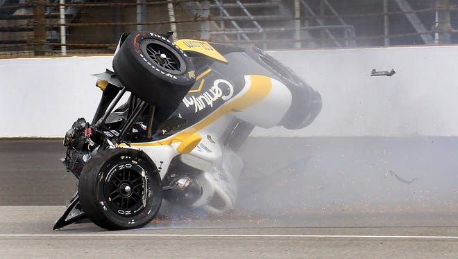 Josef Newgarden slides with his car inverted after he hit the wall and flipped coming out of Turn 1 during practice for the Indianapolis 500 on May 14, 2015, at the Indianapolis Motor Speedway.