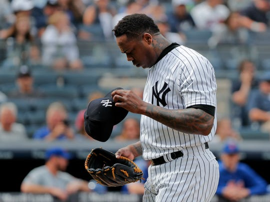 New York Yankees relief pitcher Aroldis Chapman walks off the field during the ninth inning of a baseball game against the New York Mets, Saturday, July 21, 2018, in New York.
