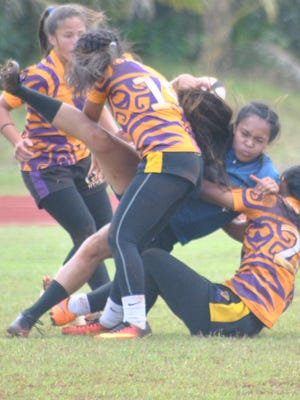 Action from the high school girls rugby match between the five-time defending champion George Washington Geckos and the Academy of Our Lady of Guam Cougars on Jan. 21, 2017 at Okkodo High School in Dededo. GW won the match 21-0.