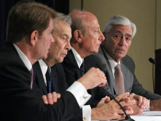 John K. Lloyd (right), president and CEO of Meridian Health, looks over to (from left) Robert C. Garrett, president and CEO of Hackensack University Health Network; Joseph Simunovich, chairman of Hackensack; and Gordon Litwin, chairman of Meridian, during an October 2014 news conference about the proposed merger.