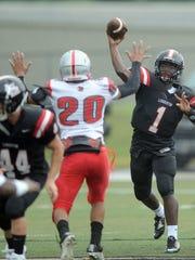 Lumberton quarterback Jared Tribett throws the ball