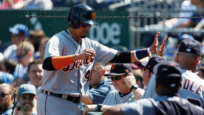 Tigers designated hitter Victor Martinez, left, is congratulated after scoring in the first inning at Kauffman Stadium in Kansas City, Mo., Saturday, May. 5, 2018.