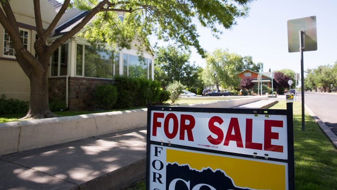 A home is for sale on the corner of West Las Cruces Avenue and North Miranda Street Wednesday, April 19, 2017. Home sales have increased significantly in 2018.