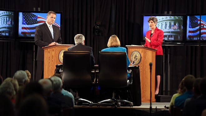 Joni Ernst (at right), the GOP candidate for U.S. Senate, speaks during a debate with Democratic candidate Bruce Braley on Sunday, Sept. 28, 2014, at Simpson College in Indianola, Iowa.