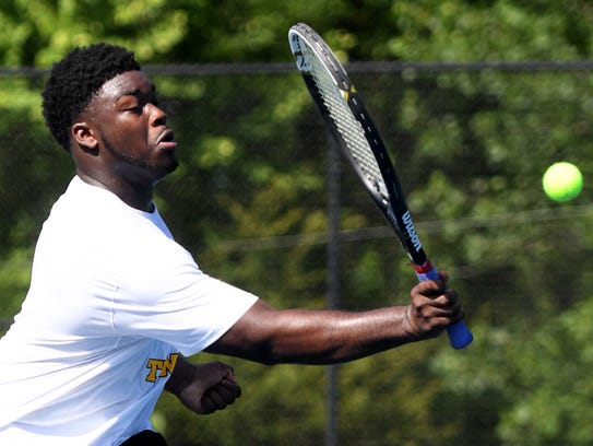 Peabody's Robert Clark returns a volley during the
