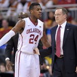 Oklahoma guard Buddy Hield talks with coach Lon Kruger earlier this month. Hield is Oklahoma's leading scorer and a difficult task for Denzel Valentine today.