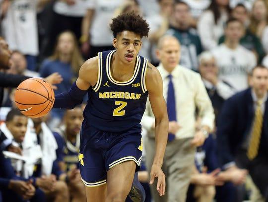 Michigan guard Jordan Poole brings the ball up court