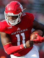 Sep 16, 2017; Piscataway, NJ, USA;  Rutgers Scarlet Knights quarterback Johnathan Lewis (11) rushes for a touchdown against the Morgan State Bears during the first half at High Point Solutions Stadium. Mandatory Credit: Noah K. Murray-USA TODAY Sports
