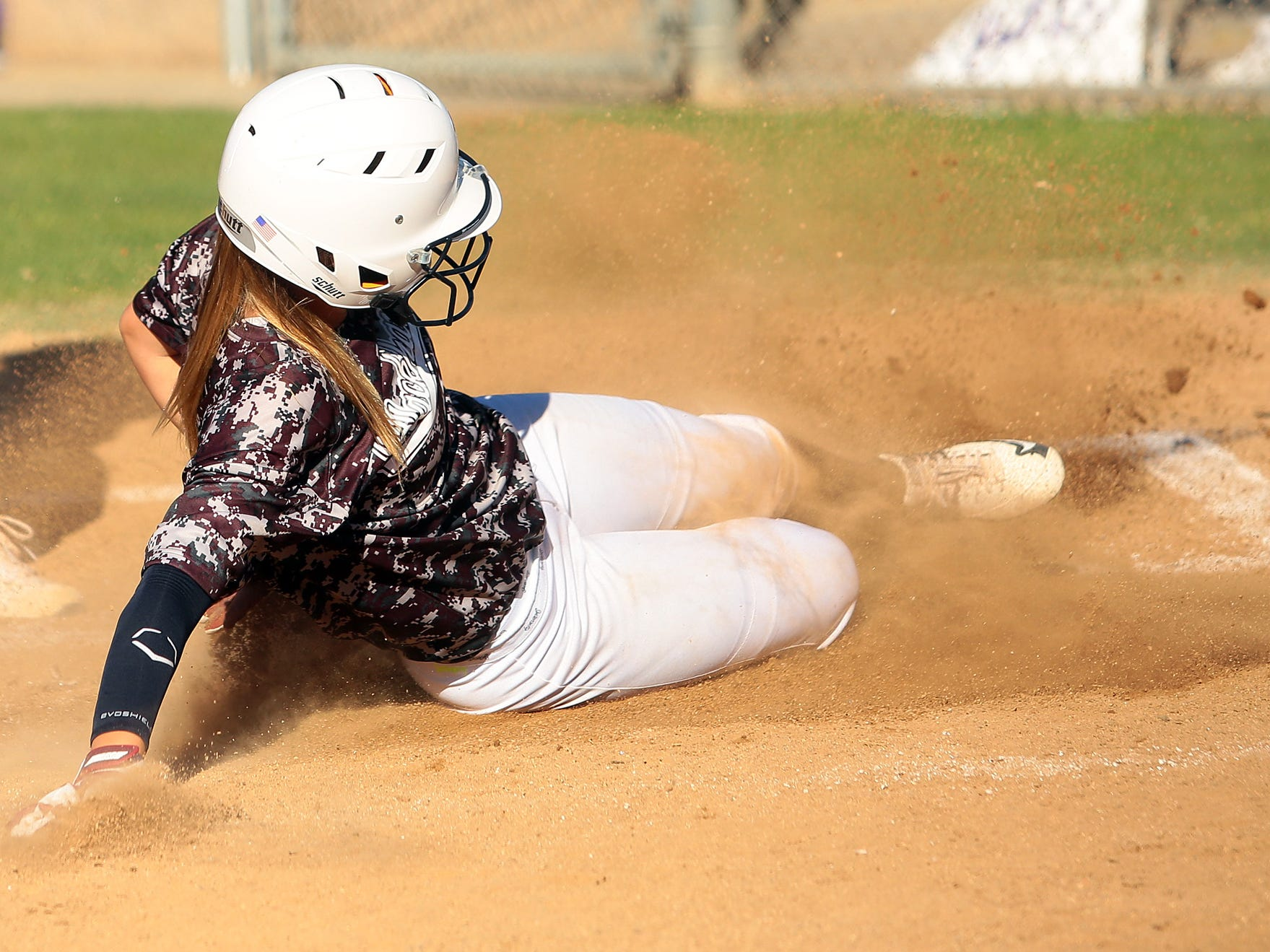 La Quinta's Hanna Zanesco (12) slides into to home plate and scores against Shadow Hills during the fifth inning of an afternoon game Thursday. The schools played a double header and La Quinta won the first game 7-5 and the second 4-1.