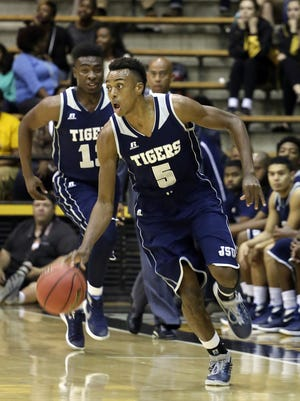 Jackson State's Paris Collins (5) and Javeres Brent, pictured behind Collins, have both been big for the banged up Tigers.