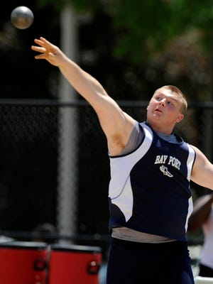 Cole Van Lanen of Bay Port sends the shotput flying in the boys Division 1, flight 3 shotput event during the WIAA state track and field events on Friday, June 6, 2014 at the University of Wisconsin-La Crosse in La Crosse. Matthew Apgar/HTR Media