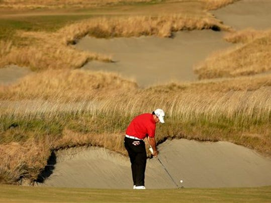 Patrick Reed hits from the fairway on the 18th hole during the second round of the U.S. Open golf tournament at Chambers Bay on Friday, June 19, 2015 in University Place, Wash. (AP Photo/Charlie Riedel)