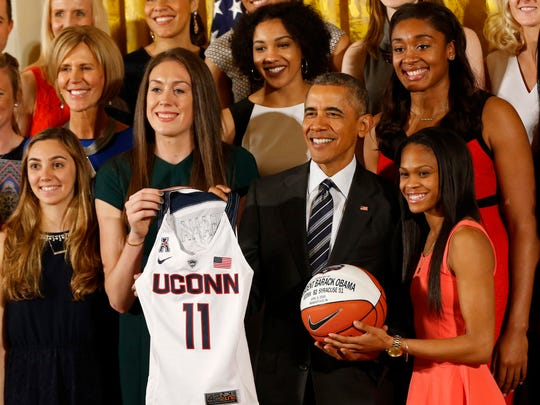 President Barack Obama (middle) poses with Connecticut Huskies forward Breanna Stewart (second from left), Huskies guard Moriah Jefferson (second from right) and other team members at a May 10 ceremony honoring the 2016 NCAA women's basketball champion Huskies in the East Room at the White House. The Huskies, members of the American Athletic Conference, stand a good chance of being part of a Big 12 expansion, writes the Register's Randy Peterson.