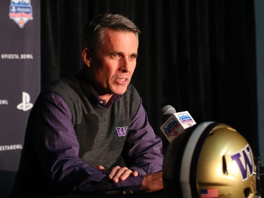 Washington head coach Chris Petersen discusses the Fiesta Bowl after arriving in Phoenix Monday night.
