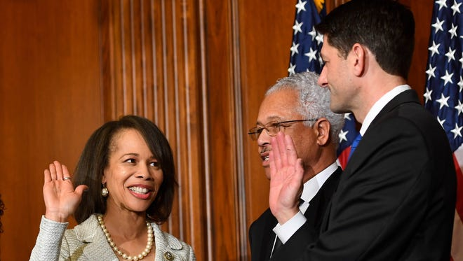 Rep. Lisa Blunt Rochester, D-Del., stands with House Speaker Paul Ryan, R-Wis., for a ceremonial swearing-in on Jan. 3, 2017. She made history as the first woman and African American to represent Delaware in Congress.