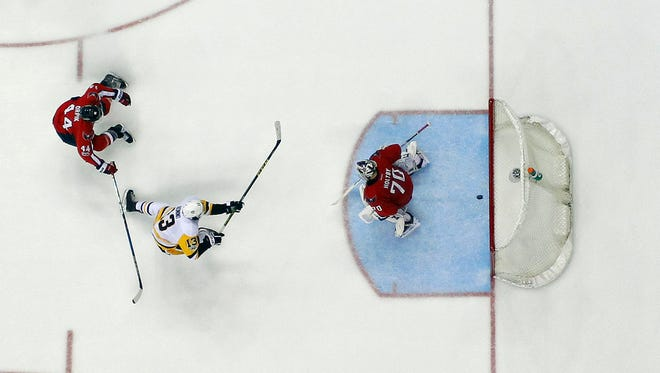 Pittsburgh Penguins center Nick Bonino scores against Washington Capitals goalie Braden Holtby on a breakaway in the third period.