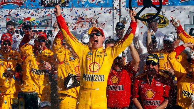 Joey Logano celebrates winning the Daytona 500 at Daytona International Speedway.