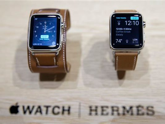 The new Apple Watch with a Hermes band is displayed following an Apple event Wednesday, Sept. 9, 2015, in San Francisco. Apple staked a new claim to the living room on Wednesday, as the maker of iPhones and other hand-held gadgets unveiled an Internet TV system that's designed as a beachhead for the tech giant's broader ambitions to deliver a wide range of information, games, music and video to the home.