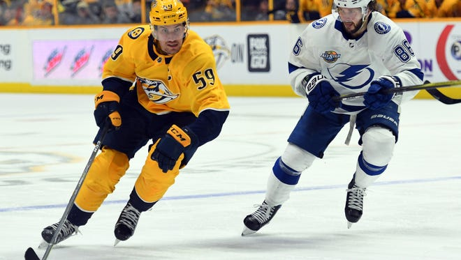 Predators captain Roman Josi handles the puck Tuesday during the team's overtime loss to the Tampa Bay Lightning.