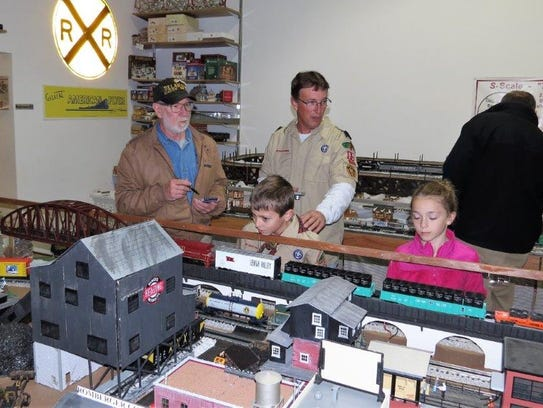 Young visitors admire a display at the railroad club.