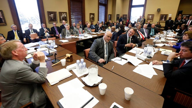 Members of the House Ways and Means Committee discuss the incentives for a tire plant in western Hinds County and a shipyard in Gulfport, Thursday, Feb. 4, 2016 at the Capitol in Jackson, Miss. Gov. Phil Bryant set Thursday's special session for two economic development projects that could create 3,500 jobs.