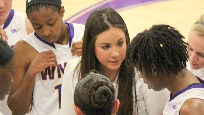 Western head coach Lauren Unger talks with her team during action Monday night.