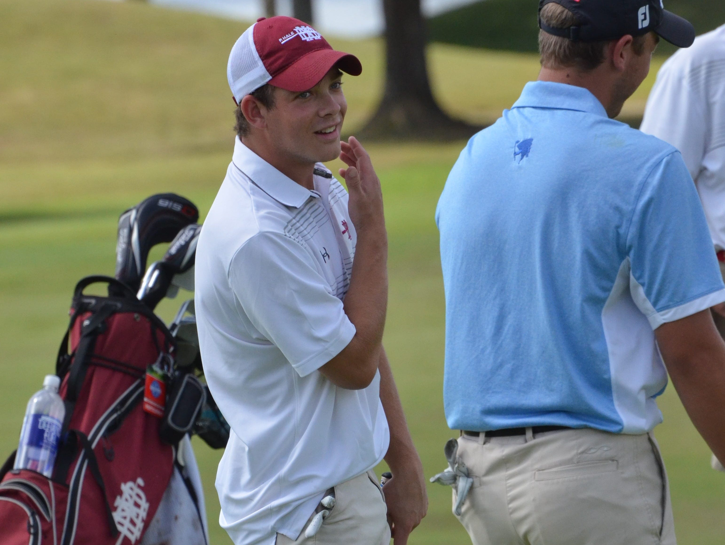 MBA's Connor Downey reacts after narrowly missing a putt on the No. 18.