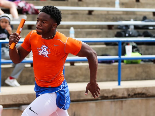 Central's Demarcus Cobb runs in the 4X100 during the