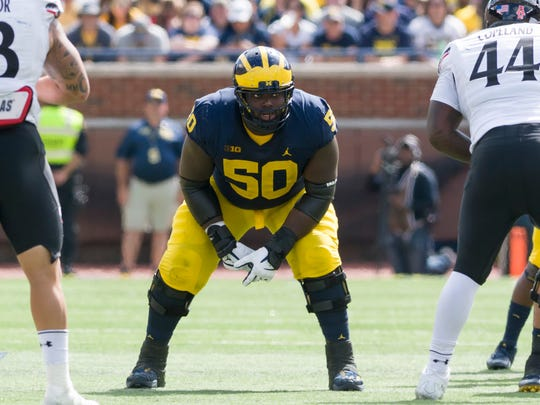 Michael Onwenu has been locked in at right guard most of his college career, has made 21 starts in 33 games, and is among the four returning offensive line starters.