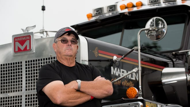 Clyde Stevenson of Salisbury, Md., stands in front of his 1996 Marmon truck that was on display at the truck convoy benefiting Special Olympics Delaware at the Delaware State Fairground in Harrington.