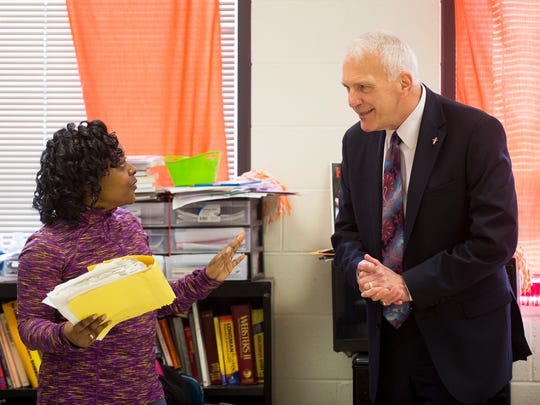 New Knox County Schools superintendent Bob Thomas, right, talks with Austin-East Magnet High School teacher Rukiya Foster, left, during a tour of the school on Friday, April 7, 2017.