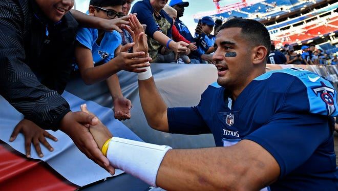 Titans quarterback Marcus Mariota (8) greets fans after the Titans 23-20 victory over the Ravens at Nissan Stadium Sunday, Nov. 5, 2017 in Nashville, Tenn.