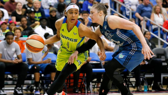 The Dallas Wings' Skylar Diggins moves the ball to the basket against the Minnesota Lynx's Lindsay Whalen, right, in the second half of a July 17 game in Arlington, Texas.