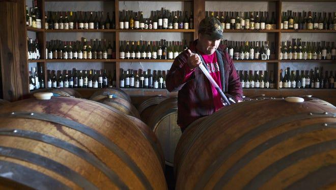 Todd Bostock draws wine,  from a barrel for tasting at Dos Cabezas WineWorks, 3248 AZ-82, Sonoita, Arizona.