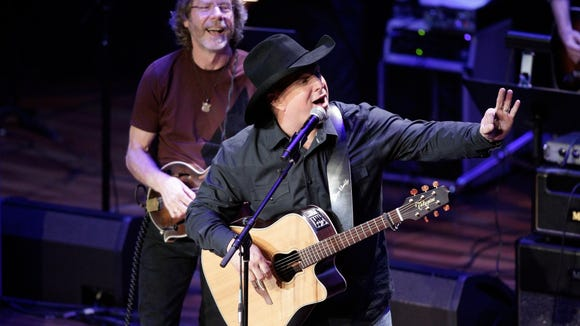Garth Brooks and Sam Bush perform during the 54th Annual ASCAP Country Music Awards at the Ryman Auditorium on Monday, Oct. 31 2016 in Nashville, Tenn. (Photo byWade Payne/Invision/AP)