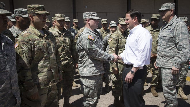Governor Doug Ducey talks to Arizona National Guard members, April 9, 2018, at the Papago Park Military Reservation in Phoenix.