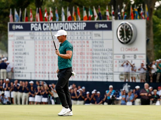 Brooks Koepka is cheered on the 18th green as he wins the PGA Championship golf tournament at Bellerive Country Club, Sunday, Aug. 12, 2018, in St. Louis. (AP Photo/Brynn Anderson)