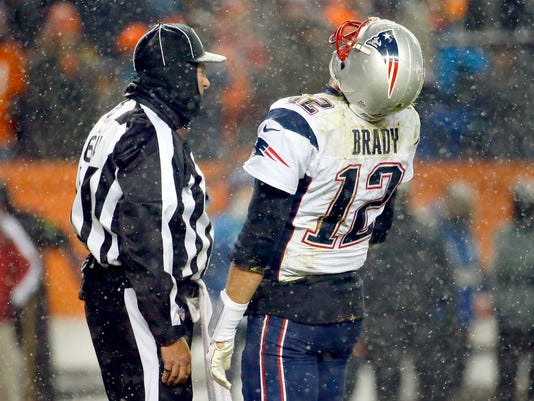 New England Patriots quarterback Tom Brady (12) reacts to a call during the second half of an NFL football game against the Denver Broncos, Sunday, Nov. 29, 2015, in Denver. (AP Photo/Jack Dempsey)