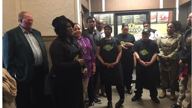 Charley Hawkins, at left, the owner of Charley's Good Ground Kitchen and Juicery, celebrated a grand opening of her restaurant Tuesday at 28 Park Avenue West.