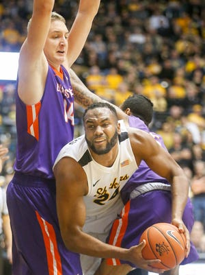 Wichita State center Shaquille Morris tries to squeeze through Evansville center Sergej Vucetic, left, and Evansville forward Solomon Hainna during the first half at Koch Arena in Wichita, Kansas, Tuesday, Feb. 21, 2017.