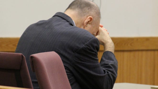 Martin Edward Zale bows his head as the verdict is read Thursday afternoon in Livingston County Circuit Court.
