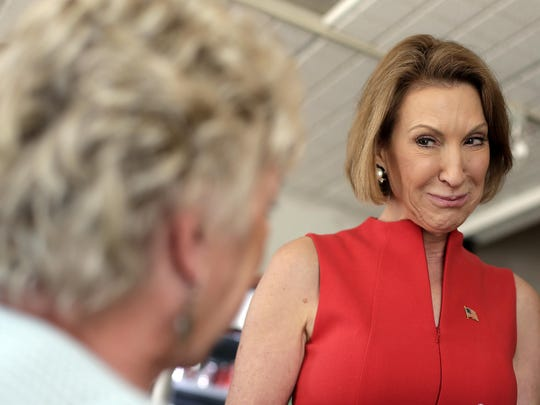 Republican presidential candidate Carly Fiorina talks to a restaurant patron during a campaign stop at the Starboard Market on Friday in Clear Lake. She also appeared at a town hall in nearby Mason City.