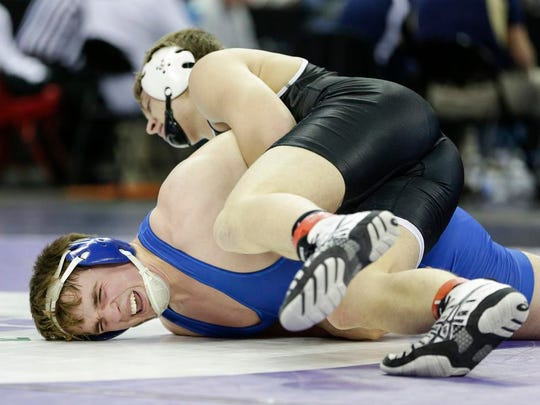 North Fond Du Lac/Saint Mary's Marcus Orlandoni struggles with Prescott's Ty Sanford in the 195-pound Division 2 quarterfinals Friday at the Kohl Center in Madison.