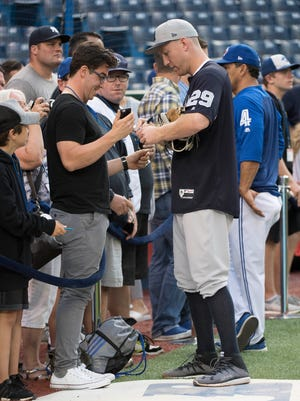 New York Yankees third baseman Todd Frazier (29) signs autographs during batting practice before a game against the Toronto Blue Jays at Rogers Centre on Friday, Sept. 22, 2017.