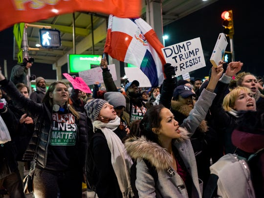 Protesters block an intersection near Terminal 4 at John F. Kennedy International Airport in New York, Saturday, Jan. 28, 2017, after earlier in the day two Iraqi refugees were detained while trying to enter the country. On Friday, Jan. 27, President Donald Trump signed an executive order suspending all immigration from countries with terrorism concerns for 90 days. Countries included in the ban are Iraq, Syria, Iran, Sudan, Libya, Somalia and Yemen, which are all Muslim-majority nations.