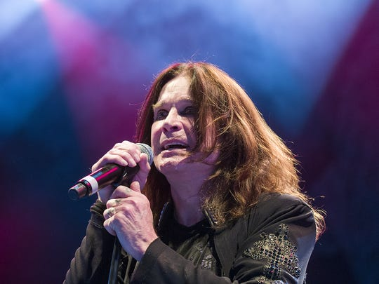 Ozzy Osbourne performs on stage with Black Sabbath