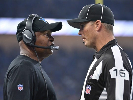Lions coach Jim Caldwell talks to line judge Kevin Codey during the game against the Falcons at Ford Field on Sept. 24, 2017.