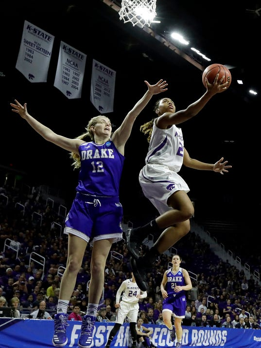 Kansas State's Karyla Middlebrook (21) gets past Drake's Brenni Rose (12) to put up a shot during the first half of a first-round game in the NCAA women's college basketball tournament Saturday, March 18, 2017, in Manhattan, Kan. (AP Photo/Charlie Riedel)