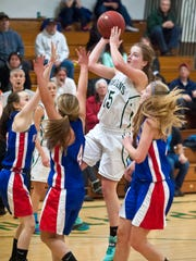 Winooski's Amanda Nattress shoots against Hazen during a girls basketball game in Winooski last season.