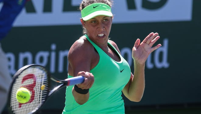 American Madison Keys returns the ball to Mariana Duque-Marino, of Columbia, on Saturday, March 11, 2017 during the BNP Paribas Open in Indian Wells, CA.